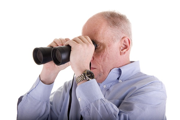 Old Guy in Blue Shirt Looking Right Through Binoculars